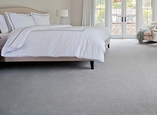 Bedroom scene with light gray Stainmaster carpet